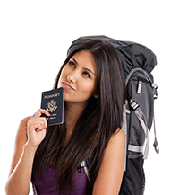 A young woman holding her new passport, wearing a backpack